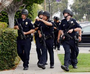 SANTA MONICA, CA - JUNE 07:  Santa Monica Police officers prepare to search the campus of Santa Monica College after multiple shootings were reported on the campus June 7, 2013 in Santa Monica, California. Six people were killed in the rampage, according to news reports. (Photo by Kevork Djansezian/Getty Images)