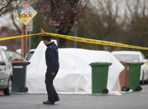 Police at the scene of a shooting on McKee Road in Finglas, Dublin, in the north of the city, shortly before 3:15pm, whicjh left a man seriously wounded. PRESS ASSOCIATION Photo. Picture date: Monday February 29, 2016. See PA story POLICE Shooting Ireland. Photo credit should read: Brian Lawless/PA Wire