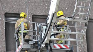 Firemen at the scene on May Street. Pic BBC