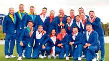 Bjorn winner: captain Thomas Bjorn of Europe holds the trophy as European players and vice-captains celebrate victory following the singles matches of the 2018 Ryder Cup