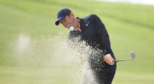 Rory McIlroy of Northern Ireland hits out of a bunker on the fourth hole of the South Course at Torrey Pines Golf Course during the third round of the Farmers Insurance golf tournament Saturday Jan. 25, 2020, in San Diego. (AP Photo/Denis Poroy)