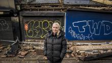 Andrea Millen who owns Valley Barbers pictured behind damaged during Storm Dennis on the Gilnahirk Road in Dundonald on February 16th 2020 (Photo by Kevin Scott for Belfast Telegraph)