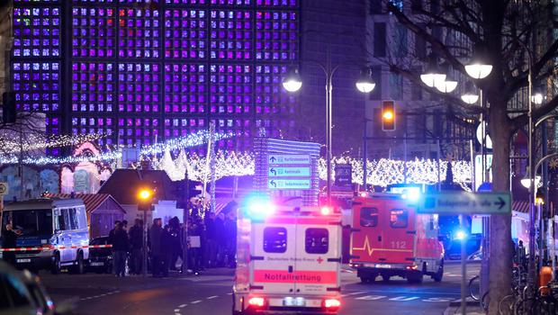 BERLIN, GERMANY - DECEMBER 19:  An ambulance and rescue workers arrive to the area after a lorry truck ploughed through a Christmas market on December 19, 2016 in Berlin, Germany. Several people have died while dozens have been injured as police investigate the attack at a market outside the Kaiser Wilhelm Memorial Church on the Kurfuerstendamm and whether it is linked to a terrorist plot.  (Photo by Sean Gallup/Getty Images)