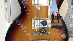 A Gibson guitar signed by all four members of Pink Floyd is up for auction (Chippenham Auction Rooms/PA)