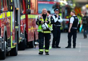 Emergency services at the scene after a fire engulfed the 27-storey Grenfell Tower in west London.  Steve Paston/PA Wire