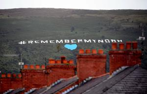 Remember My Noah written in huge white letters placed on Black Mountain overlooking Belfast today. Credit: Justin Kernoghan