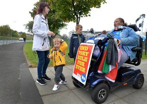 "GLASGOW, SCOTLAND - SEPTEMBER  18:  ""Yes"" Campaigner Paula Fummey talk to a voter at St Bartholomew's Primary School in Castlemilk as the people of Scotland take to the poles to decide their country's fate in a historic vote on September 18, 2014 in Glasgow, Scotland. After many months of campaigning the people of Scotland today head to the polls to decide the fate of their country. The referendum is too close to call but a Yes vote would see the break-up of the United Kingdom and Scotland would stand as an independent country for the first time since the formation of the Union. (Photo by Mark Runnacles/Getty Images)"