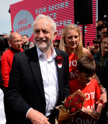 Britain's main opposition Labour Party leader Jeremy Corbyn leaves after attending a campaign visit in Colwyn Bay, north Wales on June 7, 2017, on the eve of the general election. Britain on Wednesday headed into the final day of campaigning for a general election darkened and dominated by jihadist attacks in two cities, leaving forecasters struggling to predict an outcome on polling day. / AFP PHOTO / Oli SCARFFOLI SCARFF/AFP/Getty Images