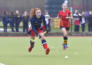 Mandatory Credit: Rowland White / PressEye Belfast Telegraph Schools' Cup Semi-Final Teams: Banbridge Academy (red) v Ballyclare High School (blue) Venue: Lisnagarvey Date: 11th February 2015 Caption: Zoe Wilson, Ballyclare