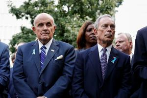 (R-L) Former New York Mayors Michael Bloomberg and Rudy Giuliani attend the 14th Anniversary ceremony of the terrorist attacks at the 9/11 memorial on September 11, 2015 in New York. AFP PHOTO/KENA BETANCURKENA BETANCUR/AFP/Getty Images