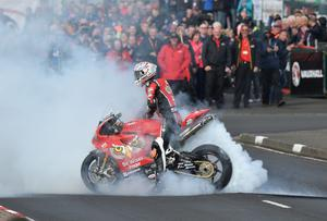 Big burn-out by winner Glenn Irwin after the superbike feature race. Rowland White / PressEye