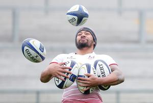 Keeping possession: Charles Piutau in training yesterday