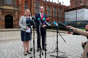 Northern Ireland Secretary Karen Bradley and Ireland's foreign minister Simon Coveney speak to the media at an event to mark the 20th anniversary of the Good Friday Agreement, at Queen's University in Belfast. PRESS ASSOCIATION Photo. Picture date: Tuesday April 10, 2018. See PA story ULSTER GoodFriday. Photo credit should read: Brian Lawless/PA Wire