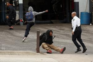 BALTIMORE, MD - APRIL 27:  Baltimore Police Commissioner Anthony Batts chases away protestors in a parking lot on Reisterstown Road near Mowdamin Mall, April 27, 2015 in Baltimore, Maryland. The funeral service for Freddie Gray, who died last week while in Baltimore Police custody, was held on Monday morning. (Drew Angerer/Getty Images)