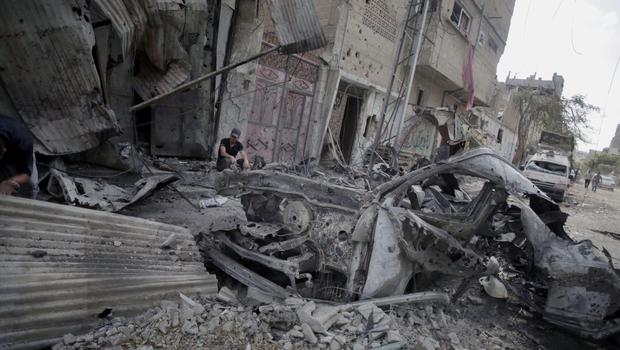 A Palestinian man inspects the destruction during a 12-hour cease-fire in Gaza City's Shijaiyah neighborhood, Saturday, July 26, 2014.(AP Photo/Khalil Hamra)