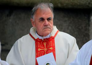 Fr. Aidan Troy attends the funeral of Dr Edward Daly at St Eugene's Cathedral in Londonderry. PA