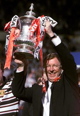 File photo dated 22/05/1999 of Manchester United manager Alex Ferguson lifts the FA Cup following his sides 2-0 victory over Newcastle United in the FA Cup final at Wembley. PRESS ASSOCITAION Photo. Issue date: Wednesday May 8, 2013. Sir Alex Ferguson will retire at the end of this season, Manchester United have announced. See PA Story SOCCER Man Utd. Photo credit should read: Owen Humphreys/PA Wire.