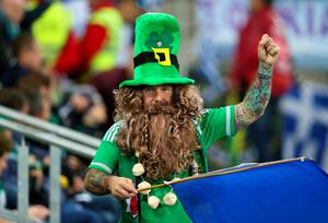 A Northern Ireland fan in the stands during the UEFA European Championship Qualifying match at Windsor Park, Belfast.