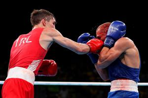 RIO DE JANEIRO, BRAZIL - AUGUST 16:  Michael John Conlan (L) of Ireland fights Vladimir Nikitin of Russia in the boxing  Men's Bantam (56kg) Quarterfinal 1 on Day 11 of the Rio 2016 Olympic Games at Riocentro on August 16, 2016 in Rio de Janeiro, Brazil.  (Photo by Christian Petersen/Getty Images)