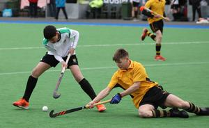 Sullivan Upper's Jack Crossan, left, in action against RBAI's Patrick McColl, during their Burney Cup Semi-Final at Instonians Hockey Club.  Photo by Peter Morrison