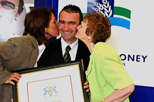 Robert Dunlop gets a peck from wife Louise and mum May after been given the Freedom of the Borough in Ballymoney.MARK JAMIESON.
