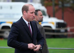 The Duke of Cambridge arrives to see the work of Lagan Search and Rescue, a rescue and lifeboat service that covers the Belfast Harbour Estate, River Lagan and the estuarial waters of Belfast Lough, in the Titanic Quarter, as part of his tour of Belfast. PRESS ASSOCIATION Photo. Picture date: Wednesday October 4, 2017. Brian Lawless/PA Wire