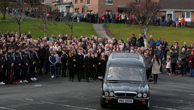 The final hearse arrives at the Holy Family chapel, Ballymagroarty in Londonderry for the funeral of the five people killed when their car slid off a slipway in Co Donegal. PRESS ASSOCIATION Photo. Picture date: Thursday March 24, 2016. Sean McGrotty and his sons Mark, 12, and Evan, eight, died along with his mother-in-law Ruth Daniels, 57, and her 14-year-old daughter Jodie Lee Daniels after their SUV sank after sliding off the pier slipway in Buncrana, Co Donegal. See PA story FUNERAL Pier. Photo credit should read: Brian Lawless/PA Wire