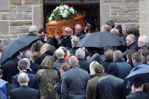 Oisin Mc Grath Funeral - St Patrick's Chruch - Holywell, Co Fermanagh Presseye Declan Roughan  Oisin's father Nigel, centre picture, carries the coffin out of the church  The funeral took place yesterday of Oisin McGrath (15 September 2001 - 12 February 2015) who died following an incident at his school, St Michael's College Enniskillen.