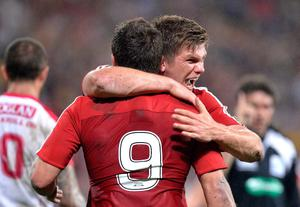 BRISBANE, AUSTRALIA - JUNE 08:  Ben Youngs of the Lions celebrates with team mate Owen Farrell after scoring a try during the match between the Queensland Reds and the British & Irish Lions at Suncorp Stadium on June 8, 2013 in Brisbane, Australia.  (Photo by Bradley Kanaris/Getty Images)