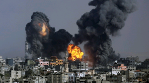 Smoke and fire from the explosion of an Israeli strike rise over Gaza City, Gaza Strip, Tuesday, July 22, 2014, as Israeli airstrikes pummeled a wide range of locations along the coastal area and diplomatic efforts intensified to end the two-week war. (AP Photo/Hatem Moussa)