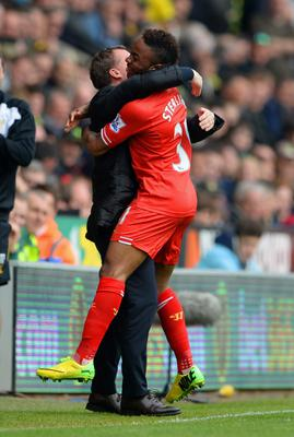 Raheem Sterling of Liverpool celebrates scoring the opening goal with Manager Brendan Rodgers of Liverpool during the Barclays Premier League match between Norwich City and Liverpool at Carrow Road on April 20, 2014 in Norwich, England.  (Photo by Michael Regan/Getty Images)