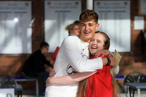 Clare-Rose Agnew and Lewis Bingham celebrate after getting their A-Level results from Banbridge Academy grammar school in Banbridge, Thursday, August 15, 2019. (Photo by Paul McErlane for the Belfast Telegraph)
