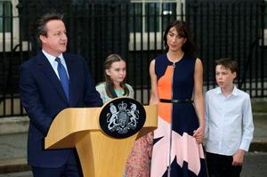 Outgoing British prime minister David Cameron (L) speaks outside 10 Downing Street beside (L-R) his daughter Nancy Gwen, his wife Samantha Cameron and son Arthur Elwen in central London on July 13, 2016 before going to Buckingham Palace to tender his resignation to Queen Elizabeth II.  AFP/Getty Images