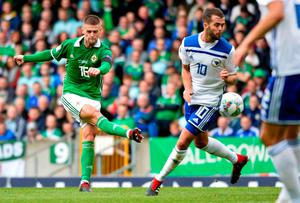 On target: NI ace Oliver Norwood fires in a shot against Bosnia-Herzegovina at Windsor Park earlier this year.