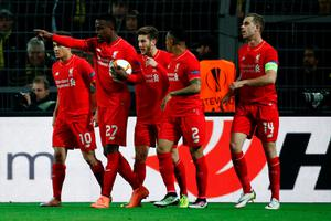 Liverpool's Belgian striker Divock Origi (2nd L) celebrates scoring the opening goal with his team-mates during the UEFA Europe League quarter-final, first-leg football match Borussia Dortmund vs Liverpool FC in Dortmund, western Germany on April 7, 2016. / AFP PHOTO / ODD ANDERSENODD ANDERSEN/AFP/Getty Images