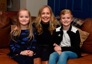 Advice: Suzanne Irvine with her children Eirin and Lochlan at their Newcastle home