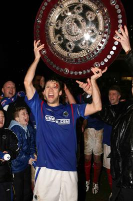 Linfield's Noel Bailie celebrating after beating Ballymena United in the Country Antrim Shield final during Linfield's 05/06 clean sweep season.