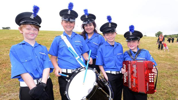 PACEMAKER BELFAST  13/07/2015:  Thousands of Orange Order members are taking part in parades across Northern Ireland. The parades mark the 325th anniversary of King William III's victory at the Battle of the Boyne in 1690. Blue Ribbon band from Belfast pictured at the Twelfth celebrations in Saintfield.  Photo Arthur Allison/Pacemaker Press