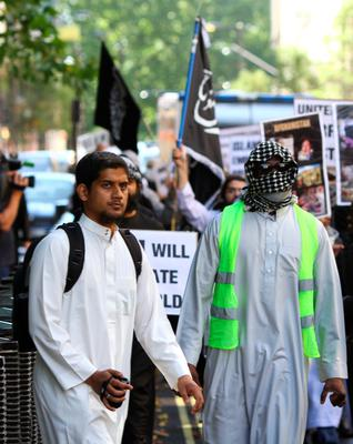 Previously unissued picture dated 11/9/2011 of Abu Rumaysah (left), formerly known as Siddhartha Dhar. Gareth Fuller/PA Wire