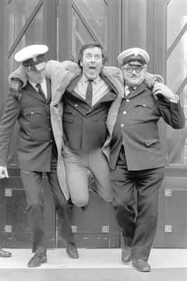 Security men pretending to frogmarch Sir Terry Wogan from Broadcasting House in London as a humourous finale to his 12 years hosting the early morning BBC 2 radio breakfast programme in 1984.