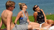 John Lennox, Kirsty McMurray, Chloe Clendinning, Ashley Jones, Thomas Pentland and Janet Martin enjoy the sunny weather at Helen's Bay in Co Down as a heatwave hits Northern Ireland in July 2013. Pic Colm Lenaghan/Pacemaker