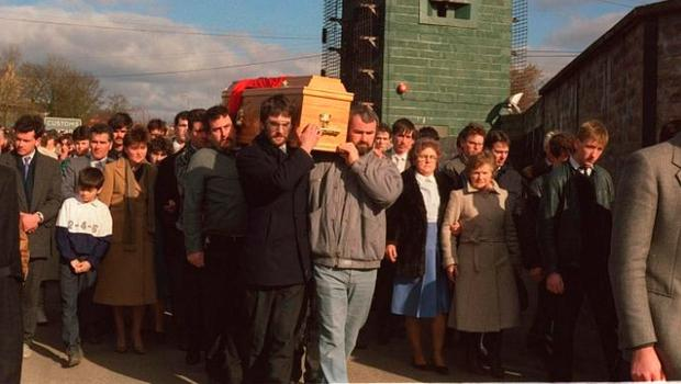 The funeral of Aidan McAnespie passes through the checkpoint where he was shot in 1988