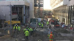 Construction workers at work on City North development site in Finsbury Park, London, the day after Prime Minister Boris Johnson put the UK in lockdown to help curb the spread of the coronavirus (Harry Davies/PA)