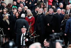 Gerry Adams (centre right) and Sinn Fein's Michelle O'Neill (centre left) arrive at St Columba's Church Long Tower, in Londonderry, where the funeral of Northern Ireland's former deputy first minister and ex-IRA commander Martin McGuinness is being held. : Brian Lawless/PA Wire