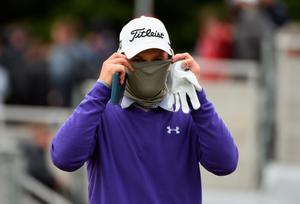 NEWCASTLE, NORTHERN IRELAND - MAY 30:  Bernd Wiesberger of Austria covers up from the cold during the Third Round of the Dubai Duty Free Irish Open Hosted by the Rory Foundation at Royal County Down Golf Club on May 30, 2015 in Newcastle, Northern Ireland.  (Photo by Ross Kinnaird/Getty Images)