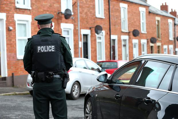 Police at scene on Oakley Street in May 2020. Photo by Pacemaker