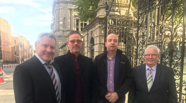 Kevin Toale, Brian Cunningham, Damian McGennity and Peter Toale, from the Border Communities Against Brexit group (Aoife Moore/PA)