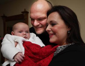@Press Eye Ltd Northern Ireland- 8th  January  2016 Mandatory Credit -Brian Little/ Presseye  Belfast Telegraph  Radio Ulster Presenters  Kerry and Ralph  McLean with four-week-old Eve.  Picture by Brian Little/Presseye