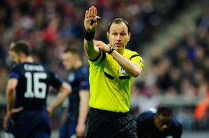 MUNICH, GERMANY - APRIL 09:  Referee Jonas Eriksson reacts during the UEFA Champions League quarter-final second leg match between FC Bayern Muenchen and Manchester United at Allianz Arena on April 9, 2014 in Munich, Germany.  (Photo by Lennart Preiss/Bongarts/Getty Images)