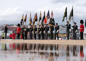 Press Eye - Belfast - Northern Ireland - 4th September 2016 -    Members of the British Legion take part in a Poppy Drop ceremony on the East Strand Beach during the Air Waves Portrush, Northern Ireland International Airshow. Organised by Causeway Coast and Glens Borough Council, over 100,000 spectators descended upon PortrushÕs eastern shoreline for two days of flying displays by some of the worldÕs most famous aviation attractions.  Photo by Kelvin Boyes / Press Eye